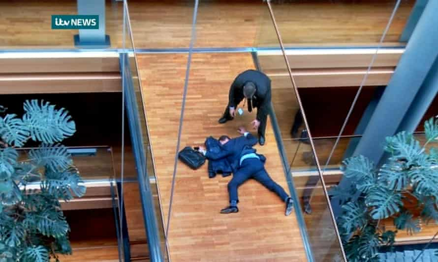 Steven Woolfe lies on the ground after losing consciousness in the European parliament