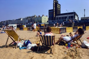 People in deckchairs on Margate beach in the 1980s