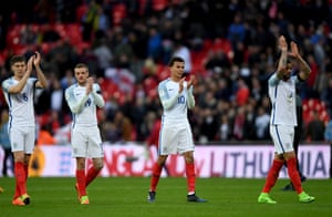 The England players applaud the fans following the final whistle.