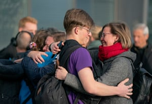 A relative welcomes one of a number of Scandinavians flown back from Peru to Copenhagen, Denmark