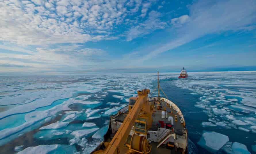 A US Coast Guard vessel follows the Canadian Coast Guard's heavy icebreaker through the icy waters of the Franklin Strait in August 2017