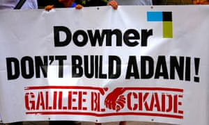 Anti Carmichael coalmine protesters hold a banner outside the AGM for the Australian diversified mining contractor Downer EDI in Sydney.
