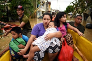 Residents are evacuated from their flooded houses in Rizal