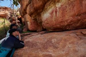 AJ Atkin and his son CJ view rock art on Ngarinyin country
