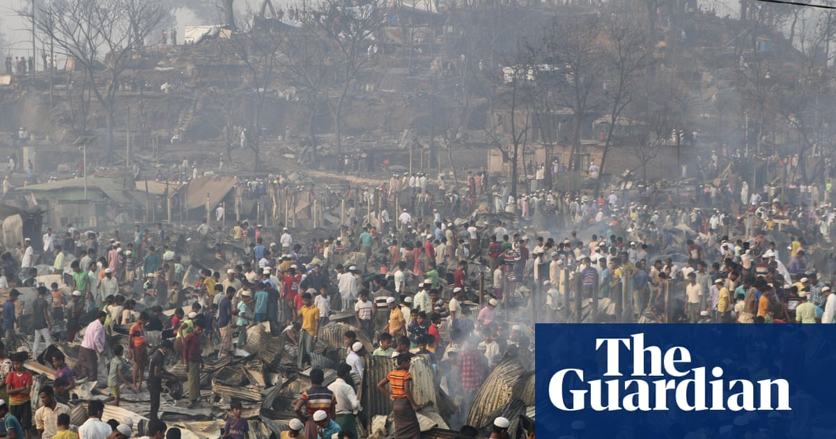 Hundreds of people missing after fire in Rohingya refugee camp in Bangladesh – video