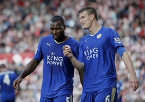 Leicester City's Robert Huth talks to Wes Morgan during the Premier League match between Stoke City and Leicester City at the Britannia Stadium