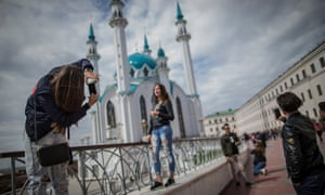 Tourists take selfies in front of the Qol Sharif mosque in Kazan, Russia.