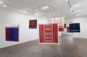 Twelve Windows, 2012-2013 (Mona Hatoum with Inaash)  12 Palestinian embroideries on fabric, wooden clothes pegs, steel cable