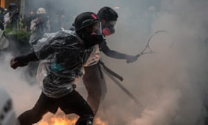 Protesters clash with police after an anti-government rally in Tsuen Wan, Hong Kong.