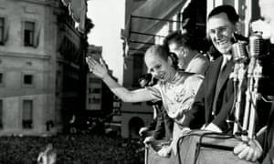 Argentinian President Juan Perón and his wife Eva wave from the balcony of Casa Rosada at Government House, Buenos Aires, 1950.