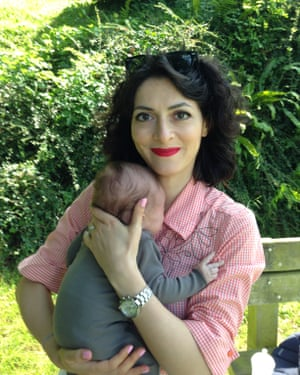 Leiris's wife, Hélène, with their son Melvil in August 2014.