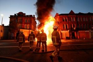 Firefighters tackle a bonfire in east Belfast
