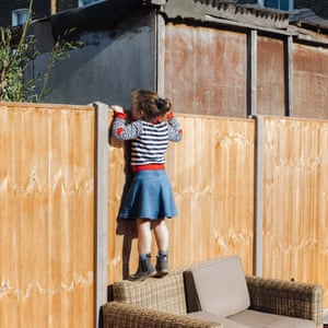 Ari Feferkorn's six-year-old daughter peers over the garden fence at the neighbour's children playing in their garden