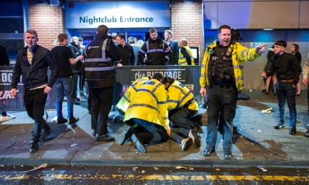 Police detain a man following a fight outside Manchester's Birdcage nightclub.