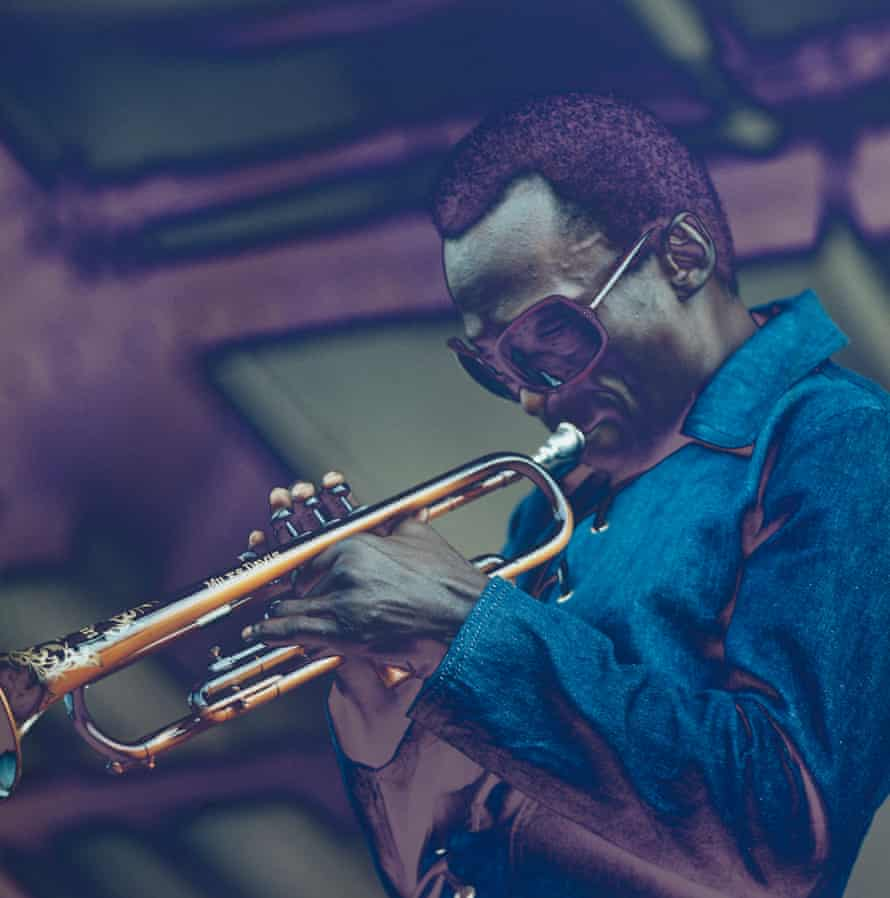 Miles Davis performs at the Newport Jazz Festival in July 1969, the month before he went into the studio to record Bitches Brew.
