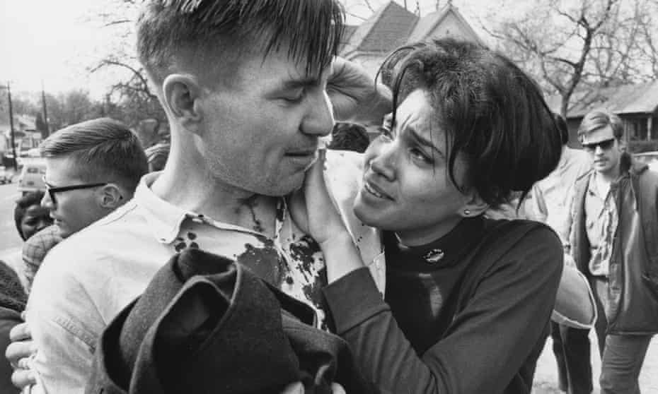 Surrounded by fellow demonstrators, student organizer Harriet Richardson comforts the poet Galway Kinnell, who had been hit with a state trooper's billy club in Montgomery, Alabama on March 16, 1965.
