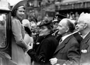Princess Elizabeth is greeted by crowds as she tours the London's East End on the day after VE Day