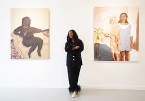 London, UK. Curator Adora Mba stands between 'Woman with Pearls Resting' by Muofhe Manavhela, on the left, and 'Why Do Shadows Fall but Never Leave' by Bria Fernandez during the preview of the Mother of Mankind exhibition, showcasing 18 black female artists, at the HOFA Gallery