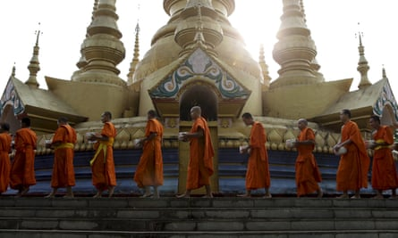 Complex picture … Buddhist monks on an alms round in Menglian, China.