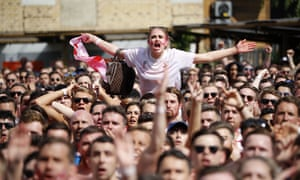 England fans watch the Russia 2018 World Cup quarter-final football match between Sweden and England on a big screen in London.