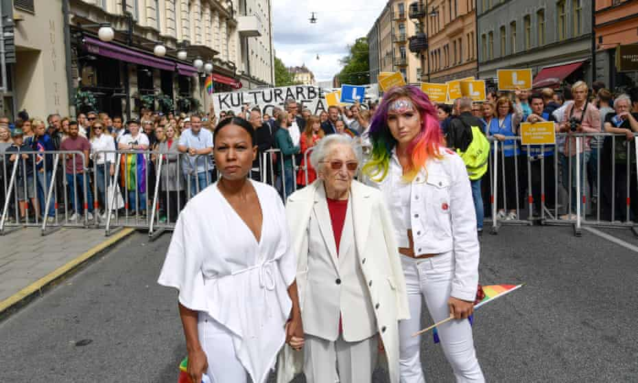 Linnéa Claeson, right, with the Swedish culture minister, Alice Bah Kuhnke, left, and holocaust survivor Hedi Fried campaign in Stockholm against the far right.