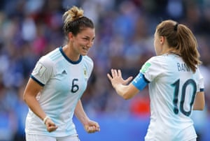 Aldana Cometti of Argentina celebrates with teammate Estefania Banini after gaining thier first ever point at a World Cup.