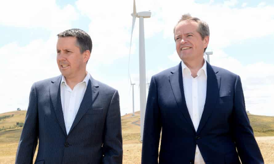 Mark Butler and Bill Shorten at Woodlawn wind farm near Canberra. Butler says Labor will not 'cop any devices to lock in low ambition' on emissions reduction.