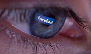 Facebook logo reflected in a person's eye