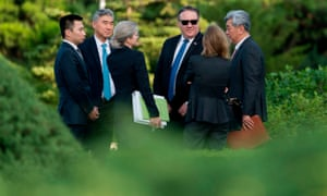 The US secretary of state, Mike Pompeo, in sunglasses, speaks with his aides after a meeting in Pyongyang with senior North Korean official Kim Yong-chol.