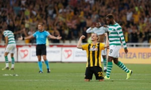 Niklas Hult celebrates at the final whistle near a dejected Moussa Dembélé after Celtic were eliminated by AEK Athens in the third qualifying round in 2018