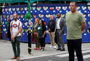 Members of the public observe a minute's silence in west London