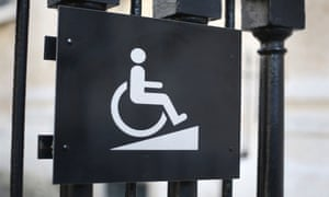 sign for disabled access on a building in central London