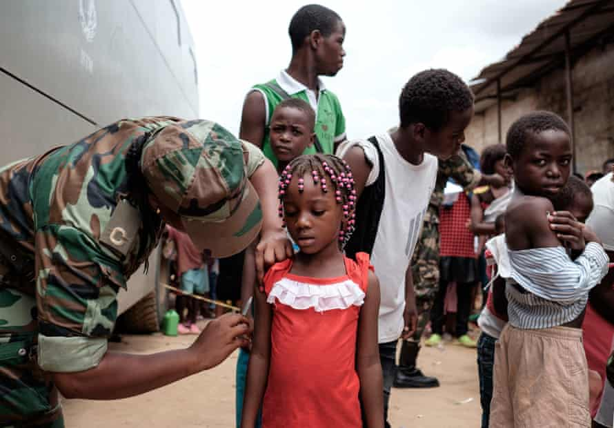 A child in Luanda, Angola, is given a yellow fever vaccine