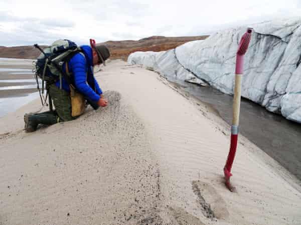 Kurt Kjær collecting sand samples at the front of Hiawatha glacier