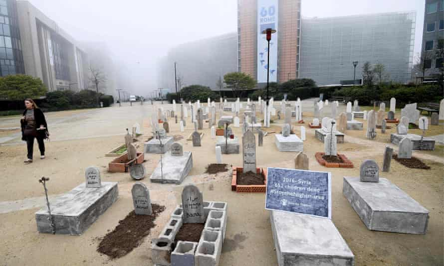 A mock cemetery set up by Save the Children in Brussels, as a reminder of the impact of six years of war on Syrian children