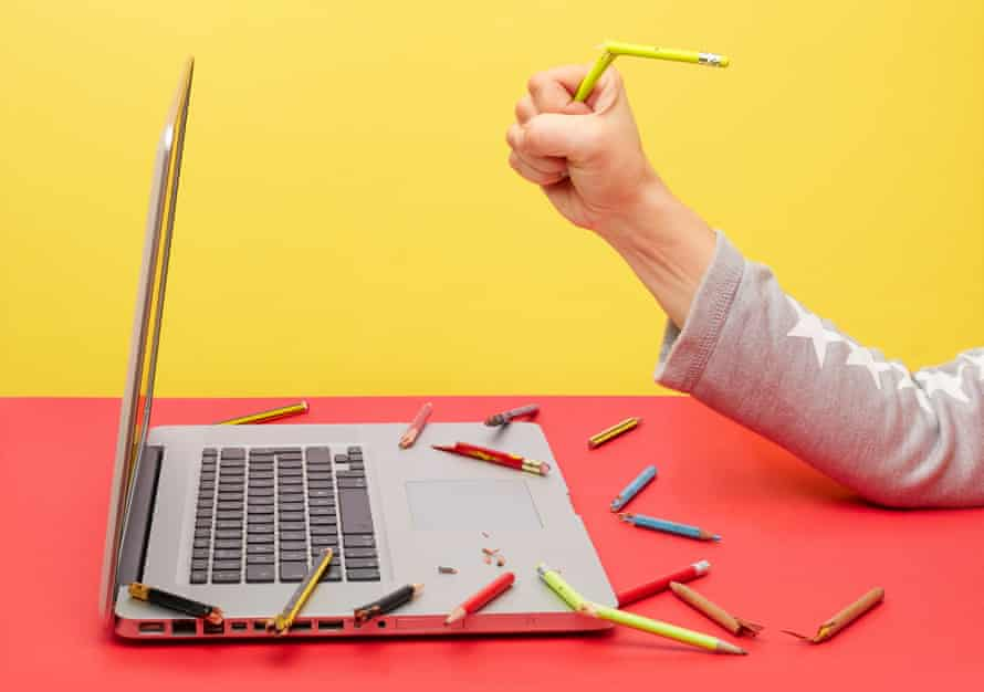 Photograph of someone's arm breaking a pencil, and broken pencils around a laptop