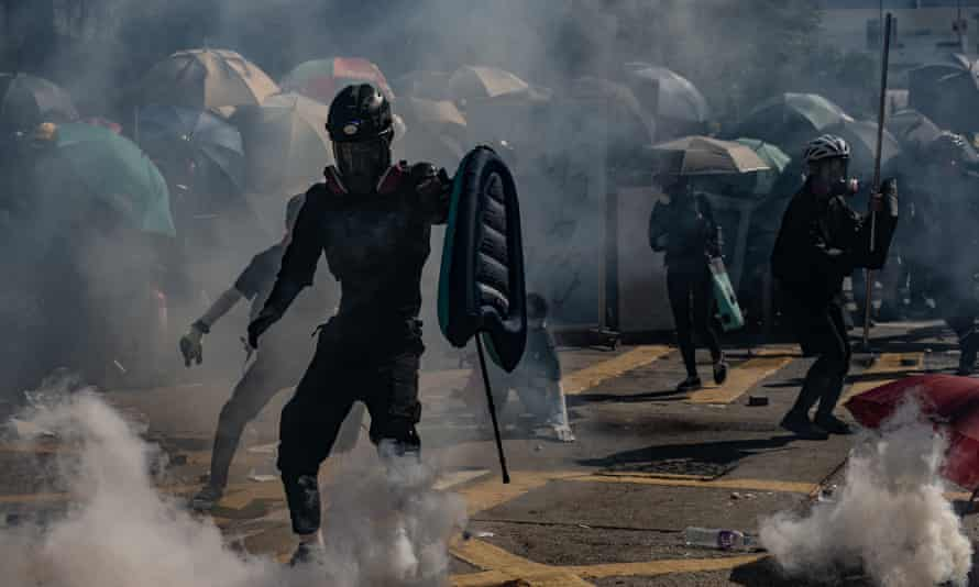 Protesters stand amid teargas fired by police during an anti-government rally in Hong Kong in November.