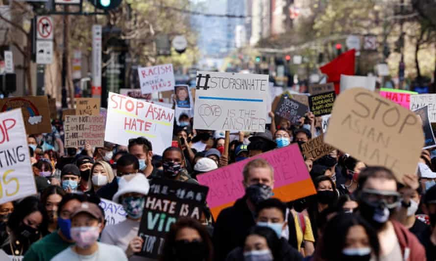 Asian Americans and Pacific Islander (AAPI), and supporters march on Market Street to condemn hate and violence against the Asian community in San Francisco, California, on 26 March 2021.