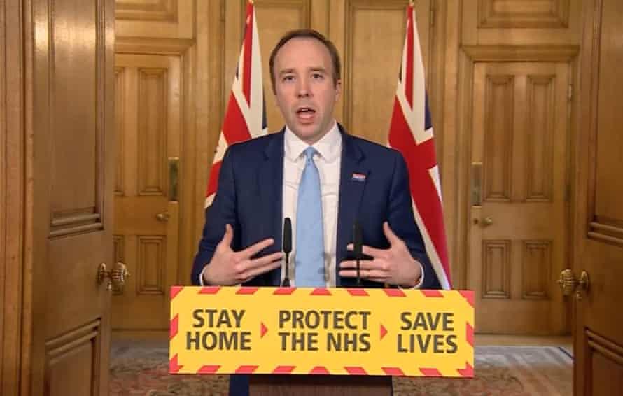 Health Secretary Matt Hancock behind a podium in Downing street