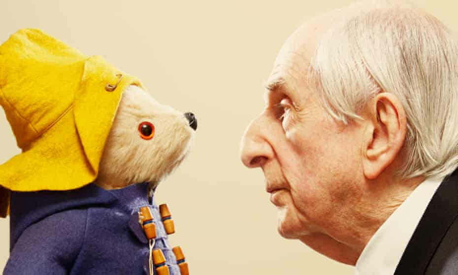 Michael Bond with his most famous creation, Paddington Bear.