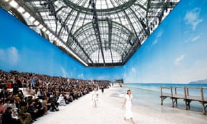 Models walk along a fake beach at Karl Lagerfeld's SS19 collection for Chanel at the Grand Palais, October 2018