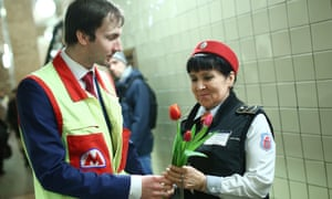 A Moscow Metro employee gives tulips to a colleague at Komsomolskaya Station of the Moscow Metro to mark Women's Day.