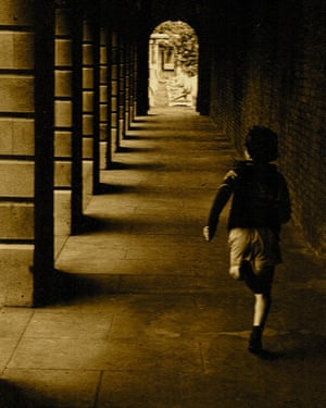 """<strong>Running by...</strong><br>A boy dashes through the Brompton Cemetery colonnade in the 1970s<br>Photograph: <a href=""""https://witness.theguardian.com/assignment/55b0f634e4b02ab2dca28ece/1641270"""">Teeell/GuardianWitness</a>"""