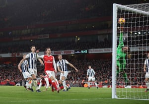 Olivier Giroud watches from the floor as his late header beats Albion goalkeeper Ben Foster to score the only goal of the game