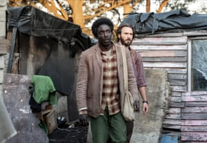 Michael K Williams and Chris Evans in a scene from the 2019 film The Red Sea Diving Resort