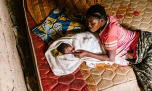 Eva Paulo at home with her baby daughter, Neema Nkwaya, one day old.