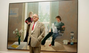 Hockney poses in front of Mr and Mrs Clark and Percy