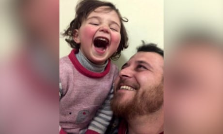 Syrian father teaches daughter to cope with shelling noise through laughter – video
