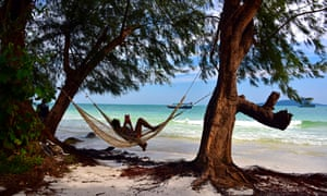 Person relaxing in hammock on Koh Rong island