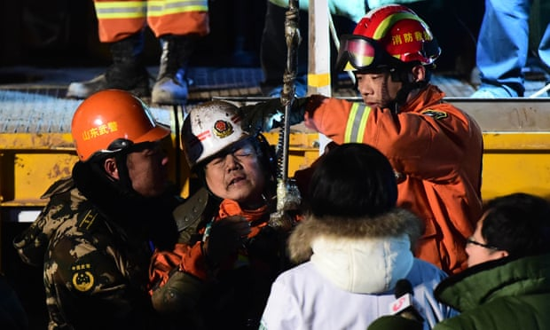 A miner is lifted from the collapsed pit in Pingyi, east China. Photograph: Xinhua/ReX/Shutterstock
